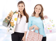 Stunning young women carrying shopping bags Stock Photo