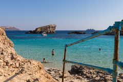 Comino blue lagoon beach. The stunningly beautiful holiday destination sandy beach of comino and crystal clear azure turquoise blue waters of the Blue Lagoon Royalty Free Stock Images