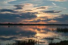 Stunningly beautiful sunset on a pond without a wind Royalty Free Stock Photography
