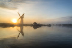 Stunnnig landscape of windmill and river at dawn on Summer morni Royalty Free Stock Photos
