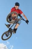 Stunt. Professional bmx biker doing a stunt jump royalty free stock image