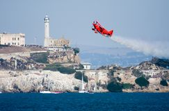 Stunt Bi-Plane. Aerobatic stunt plane in San Francisco with Alcatraz in the background Stock Image