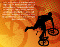 Stunt bicyclist. On the abstract background Stock Photo