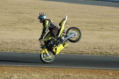 Stunt Bike. Image was taken of a stunt bike rider on its front wheel at the drift event held at the queensland raceway in australia Royalty Free Stock Images