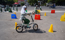 Stunt bike race. Islamic elementary school students are following the Stunt Bike race in the city of Solo, Central Java, Indonesia Royalty Free Stock Images