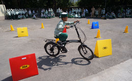 Stunt bike race. Islamic elementary school students are following the Stunt Bike race in the city of Solo, Central Java, Indonesia Stock Photo