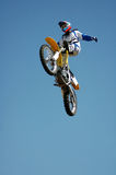 Stunt Biker. A stunt biker high up in the air. Photographed in South Africa stock photos