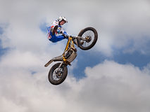 Jumping with a motorcycle trial Royalty Free Stock Image