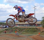 Stunt biker. Motorcycle rider making a stunt on air on the champioship of motocross Stock Images