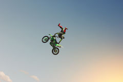 A stunt biker performs a trick in the sky Royalty Free Stock Images