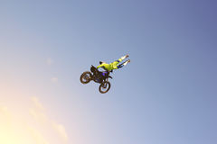 A stunt biker performs a trick in the sky Stock Photo
