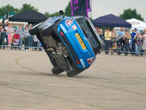 Stunt car driver Russ Swift entertains the crowds. GRIMSBY, ENGLAND - JUNE 21ST: Stunt car driver Russ Swift entertains the crowds in his Mini Cooper at the New Stock Photography