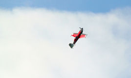 Stunt climbing up. A stunt plane climbing sharply into the clouds Stock Images