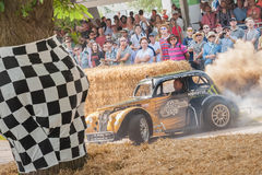 Stunt Driver. Dusty vehicle donuts performed by expert stunt driver Terry Grant at the Festival of Speed event held at Goodwood, UK on July 13, 2013 Royalty Free Stock Photo