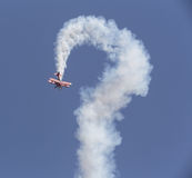 Stunt flyer airplane in the sky Stock Photography
