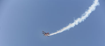 Stunt flyer airplane in the sky Stock Images