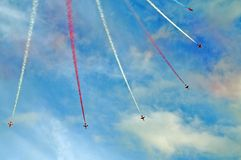Stunt flying by red arrows Stock Images