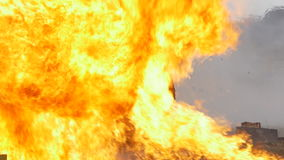Stunt girl in a fiery explosion. Slow motion. stock video footage