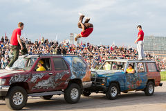 Stunt jump from one vehicle to another Stock Photography