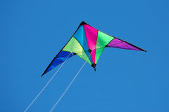 Stunt Kite. Multi Colored Stunt Kite Flying in a Blue Sky royalty free stock photo