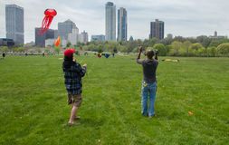 Stunt Kites. Two men flying a pair of stunt kites at a recent kite festival held in Milwaukee, Wisconsin Royalty Free Stock Photos