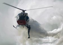 Stunt Man. Hanging on Helicopter Stock Photography