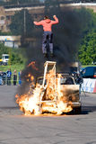 Stunt man jumps over fire. MOSCOW,RUSSIA - JUNE 6 : Stunt man Ivan Simakov jumps over fire during a Stunt man show on June 6, 2008 in Moscow Royalty Free Stock Photo