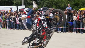 Stunt moto show. Moto rider rides on the rear wheel. Bikers parade and show. Slow Motion stock footage