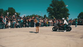 Stunt Moto Show. Moto Rider Rides on the Rear Wheel. Bikers Parade And Show. Slow Motion stock video footage