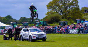 Stunt Motorbike Rider Jumps Car Stock Photo