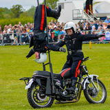 Stunt Motorbike Riders Stock Images