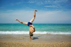 Stunt op strand Stock Foto