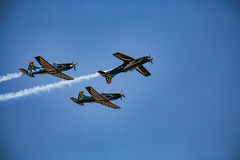 Stunt Pilot Flies Upside Down in Formation Stock Images