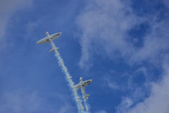 Stunt Pilots areobatics. Stunt pilots performing a dangerous and spectacular stunt Stock Images