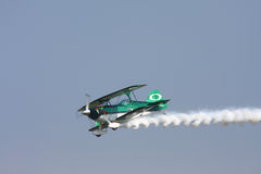 Stunt Plane. CLEVELAND, OHIO - SEPT. 3:Green and white stunt bi-plane at the Cleveland National Airshow on Sept. 3, 2011 in Cleveland, Ohio Royalty Free Stock Image