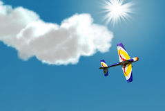 Stunt Plane. A small stunt plane doing tricks in the sky royalty free stock photography