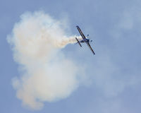 Stunt Plane performing at the 2015 MCAS Airshow. A stunt plane uses smoke as part of their practice, at the MCAS Air Show in Beaufort, SC Stock Images