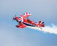 Stunt plane. Stunt pilot performs stunts in bi plane Royalty Free Stock Image