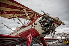 Stunt Plane. Redding, California, USA- September 28, 2014: A high performance stunt biplane and its engine are on display at an airshow in Northern California stock photos