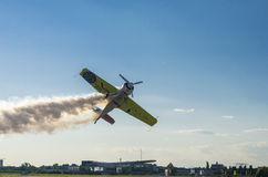 Stunt plane with smoke Stock Photography