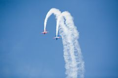 Stunt planes. Racing skywards and diving towards the ground stock photo