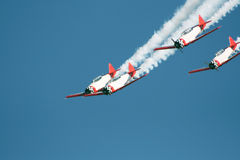 Stunt planes dive. Four stunt planes in a dive formation Royalty Free Stock Photography