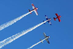 Stunt Planes in Formation. Stunt aircraft flying in formation against bright blue sky at air show performance stock photography