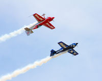 Stunt Planes performing at the 2015 MCAS Airshow. A stunt planes use smoke as part of their practice, at the MCAS Air Show in Beaufort, SC Stock Photography