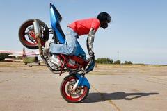 Stunt rider making stoppie. Clo royalty free stock photos