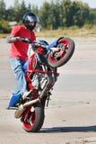 Stunt rider making wheelie. Close-up Stock Photography