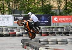 A stunt rider on a sport bike Royalty Free Stock Photo