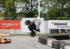 A stunt rider on a sport bike Stock Photography