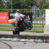 A stunt rider on a sport bike Stock Images