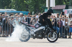 Stunt rider on a sport bike ,on a stunt battle Royalty Free Stock Photo